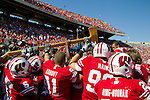 The Wisconsin Badgers football team grabs the Paul Bunyan Axe after defeating the Minnesota Golden Gophers after an NCAA college football game on October 9, 2010 at Camp Randall Stadium in Madison, Wisconsin. The Badgers beat the Golden Gophers 41-23. (Photo by David Stluka)