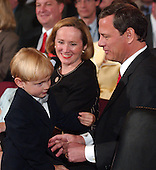 Washington, D.C. - September 12, 2005 -- Judge John G. Roberts family prior to the United States Senate Committee on the Judiciary hearing on his nomination to be Chief Justice of the United States.  Left to right: son, Jack; wife, Jane Marie Sullivan; and Judge Roberts..Credit: Ron Sachs / CNP