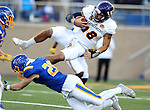 BROOKINGS, SD - SEPTEMBER 24:  Sean McGuire #18 from Western Illinois gets upended by Chris Balster #28 from South Dakota State University in the first half of their game Saturday evening at Dana J. Dykhouse Stadium in Brookings. (Photo by Dave Eggen/Inertia)