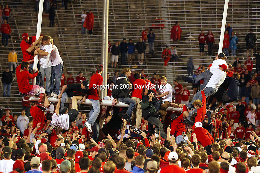 Madison, Wisconsin - 10/11/03. University of Wisconsin fans storm the field after the Wisconsin Badgers beat Ohio State 17-10  at Camp Randall Stadium. (Photo by David Stluka)