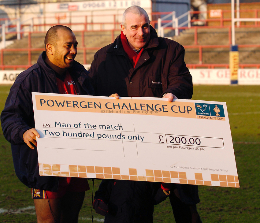 Photo: Richard Lane..London Broncos v Salford City Reds. Powergen Challenge Cup. 29/02/2004..Dennis Moran recieves the man of the match award from David Hughes.