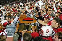 1 December 2007: Tim Mattran, Derek Hall, Matt Kopa and the fans celebrate with the Axe after Stanford's 20-13 win over California in the 110th Big Game at Stanford Stadium in Stanford, CA. Stanford leads the rivalry series over California, 55-44-11.