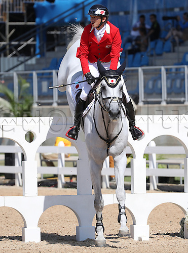 14.08.2016. Rio de Janeiro, Brazil. Daisuke Fukushima of Japan on horse Cornet 36 clears an obstacle during the Jumping Team 1st Qualifier of the Equestrian competition at the Olympic Equestrian Centre during the Rio 2016 Olympic Games in Rio de Janeiro, Brazil, 14 August 2016.