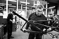 Eddy Merckx checking a frame at his home/factory where his brand/bikes used to be made in St-Brixius-Rode in 2010