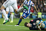 Deportivo de la Courna´s goalkeeper Fabricio receives a kick in his face from Karim Benzema during La Liga match at Santiago Bernabeu stadium in Madrid, Spain. February 14, 2015. (ALTERPHOTOS/Victor Blanco)