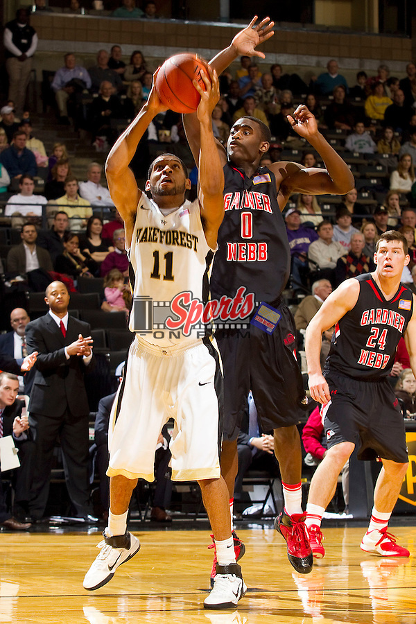 C.J. Harris #11 of the Wake Forest Demon Deacons drives to the basket past Donta Harper #0 of the Gardner-Webb Bulldogs at the LJVM Coliseum on December 18, 2011 in Winston-Salem, North Carolina.  The Demon Deacons defeated the Bulldogs 67-9.  (Brian Westerholt / Sports On Film)