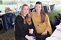 NWA Democrat-Gazette/CARIN SCHOPPMEYER Kristin Thomas (left) and Dara Bollenbacher attend Evening at the Farm.