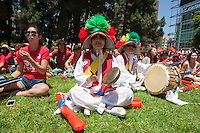 Los Angeles, CA -  Sunday, June 22, 2014: Koreans watch the South Korea vs. Algeria first round match on the  front lawn of Wilshire Park Place.