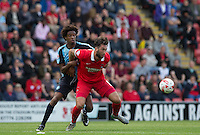 Ollie Palmer of Leyton Orient holds off Sido Jombati of Wycombe Wanderers during the Sky Bet League 2 match between Leyton Orient and Wycombe Wanderers at the Matchroom Stadium, London, England on 19 September 2015. Photo by Andy Rowland.