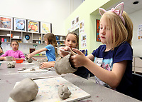 NWA Democrat-Gazette/DAVID GOTTSCHALK  Kaitlyn Gilmore, 8, works Monday, June 3, 2019, on her canopic jar during the Art of Ancient Kingdoms themed Time for Art summer program at the Community Creative Center at Walton Arts Center's Nadine Baum Studios in Fayetteville. Weekly programs are offered through the summer that include Out to Sea, On the Farm, Arctic Arts and other themes through August 9.