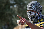 A Palestinian protester hurls a stone towards Israeli security forces during clashes following a weekly demonstration against the expropriation of Palestinian land by Israel in the village of Kfar Qaddum, near the West Bank city of Nablus on January 24, 2020. Photo by Shadi Jarar'ah