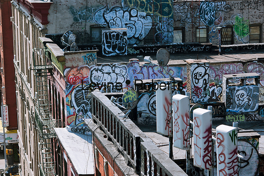 Rooftops in the New York neighborhood of Chinatown are covered with graffiti, seen on Saturday, April 21, 2012. (© Richard B. Levine)