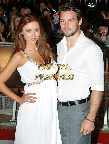 Una Healy of The Saturdays & Ben Foden.'The Twilight Saga: Breaking Dawn - Part 1' UK film premiere at Westfield Stratford City, London, England..16th November 2011.half length white dress shirt grey gray hand on hip trousers pregnant couple stubble beard facial hair gold trim.CAP/BIL.©BIL/Capital Pictures.