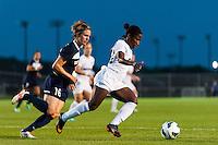 Washington Spirit forward Jasmyne Spencer (24) is marked by Sky Blue FC midfielder Sophie Schmidt (16). Sky Blue FC defeated the Washington Spirit 1-0 during a National Women's Soccer League (NWSL) match at Yurcak Field in Piscataway, NJ, on August 3, 2013.
