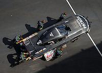 Sep 17, 2016; Concord, NC, USA; Crew members push NHRA funny car driver Alexis Dejoria during qualifying for the Carolina Nationals at zMax Dragway. Mandatory Credit: Mark J. Rebilas-USA TODAY Sports