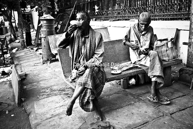 Daily wage labourers and rickshaw pullers are seen drinking their morning tea in early hours of the day in the old part of the city Ahmedabad, capital city of Gujarat, India.