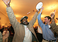 Milton, MA - Linda Dorcena Forry supporter Delroy Gordon of Dorchester was so excited when he heard the news of Linda Dorcena Forry's victory, he sent his dinner and fork flying.  Joining in the celebration  is Jeremy Traub of Newton, right.