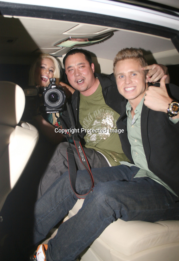 .10-14-08.Tuesday night.Heidi Montag and Spencer Pratt taking pictures with a Paparazzo named Gary Sun .After leaving the opening of a new club called 14 on Sunset. They invited to photographer inside there Rolls Royce ...AbilityFilms@yahoo.com.805-427-3519.www.AbilityFilms.com.
