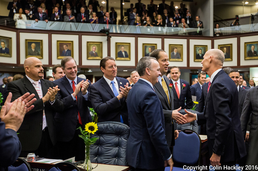 TALLAHASSEE, FLA. 1/12/16-Gov. Rick Scott, right, shakes hands with Sen. Joe Negron, R-Stuart, as Rep. Richard Corcoran, R-Land O'Lakes, next to Negron joins them during the opening day of the 2016 legislative session, Tuesday at the Capitol in Tallahassee. Rep. Ritch Workman, R-Melbourne, is at far left joined by Sen. Wilton Simpson, R-Trilby, andSen. Bill Galvano, R-Bradenton.<br /> <br /> COLIN HACKLEY PHOTO
