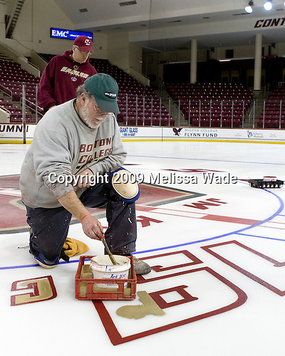 Paul Gallivan adds gold to the 19 (Brock Bradford) while Joe Russo continues to mist.  Paul Gallivan and his crew paint the numbers of any senior players and the initials of any senior managers of the men's and women's Boston College hockey teams at center ice prior to the final home game of the regular season.  On the evening of Tuesday, March 3, 2009, they painted the numbers and initials for the men's team after cutting out the women's numbers earlier that day (the women's regular season ends two weeks earlier than the men's.)