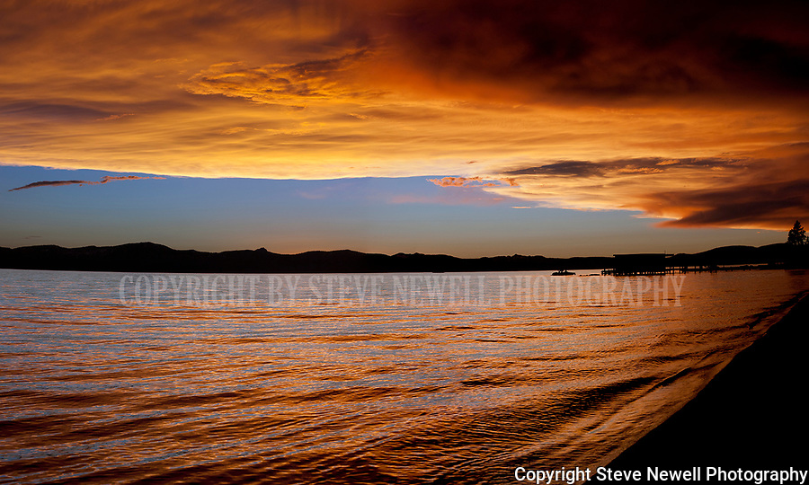 Spectacular sunset from Nevada Beach located on the Nevada side of South Lake Tahoe. I live near this beach so I run down to shoot it quite often when clouds develop over the water.