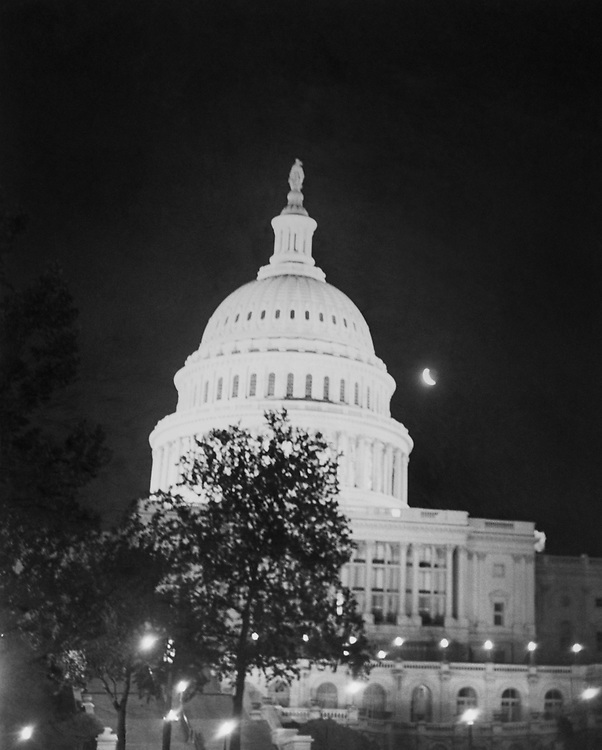 Exterior of Capitol Hill at night. (Photo by Mickey Senko/CQ Roll Call via Getty Images)