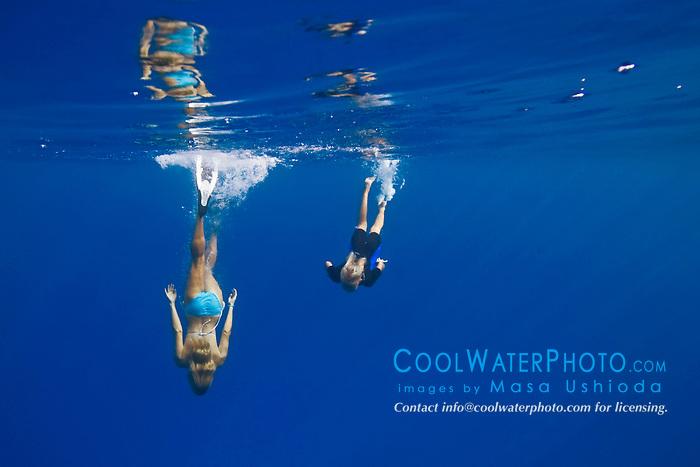 Mother and 11 years old daughter free diving, Kealakekua Bay, Big Island, Hawaii, Pacific Ocean.