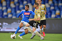 Amin Younes of SSC Napoli challenges for the ball with Francesco Vicari of SPAL during the Serie A football match between SSC Napoli and SPAL at stadio San Paolo in Naples ( Italy ), June 28th, 2020. Play resumes behind closed doors following the outbreak of the coronavirus disease. <br /> Photo Carmelo Imbesi / Insidefoto