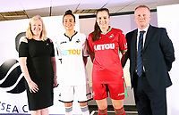 Pictured: Katy Hosford (RED) and Alicia Powe (WHITE) of the Swansea City FC Ladies' team model the home and away kits with Dsability Sport Wales and Shelter Cymru representatives. Monday 19 June 2017<br /> Re: Swansea City FC launch their new home and away kits and announce Letou as their new sponsor at the Liberty Stadium, Swansea, Wales, UK.