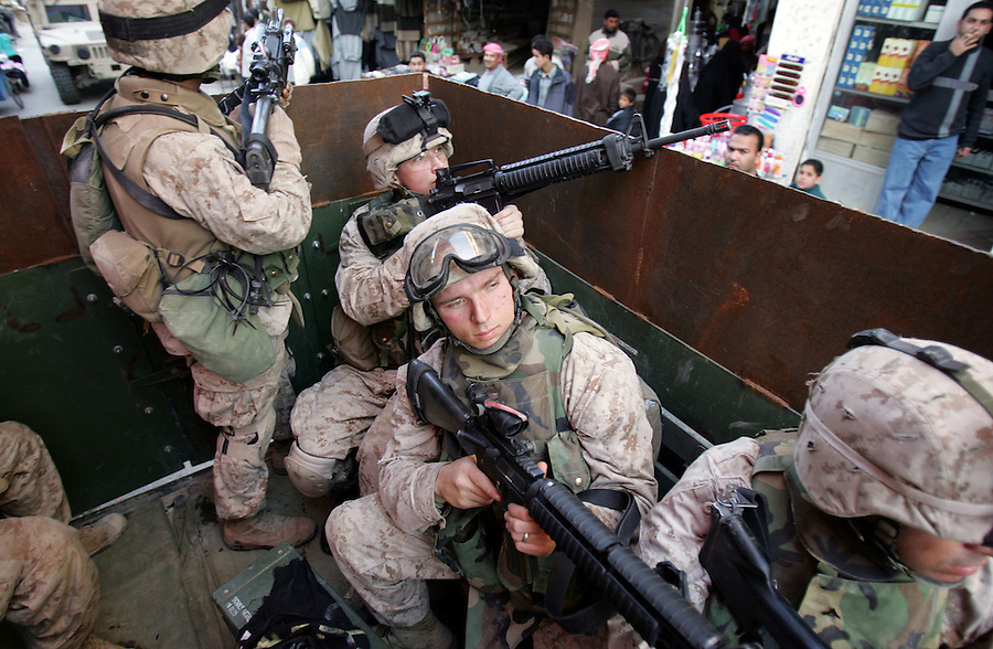 Marines with 3rd Platoon Golf Company 2nd Battalion 5th Marines carry out a patrol in Ramadi, Iraq on January 3, 2004.