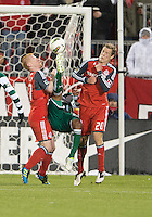 28 March 2012: Club Santos Laguna Darwin Quintero #3 attempts a bicycle kick between Toronto FC defender Ty Harden #20 and Toronto FC defender Richard Eckersley #27 during a CONCACAF Champions League game between the Club Santos Laguna and Toronto FC at BMO Field in Toronto..The game ended in a 1-1 draw...