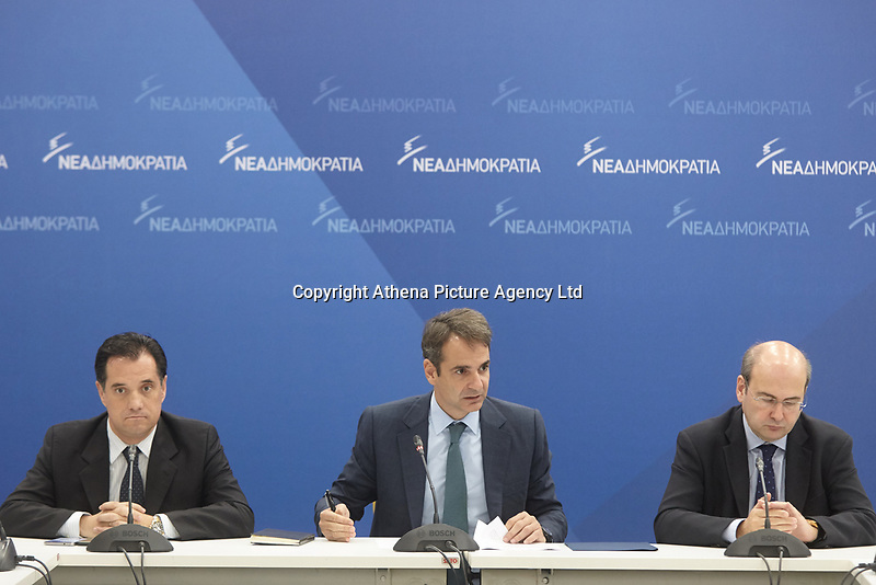 "Pictured: Adonis Georgiadis (L), deputy leader of the New Democracy party with the party leader Kyriakos Mitsotakis (C). STOCK PICTURE<br /> Re: New Democracy vice president Adonis Georgiadis said that a letter bomb sent in his name to German Finance Minister Wolfgang Schaeuble  proved that the Greek postal service (ELTA) is in ""shambles.""<br /> Georgiadis said that ""the envelope was eventually stopped at a place where serious inspections are carried out, proving that ELTA and all the other services it went through are in shambles.""<br /> The parcel addressed to Schaeuble and labeled as being sent by Georgiadis was intercepted at the German Finance Ministry. Bomb experts found that it contained an explosive material similar to that used in fireworks, which could have caused serious injuries if the parcel had been opened."