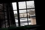 Photo shows the view toward Kosaka mine offices from inside Korakukan theater, Japan's oldest extant wooden playhouse in Kosaka, Akita Prefecture Japan on 19 Dec. 2012. Photographer: Robert Gilhooly