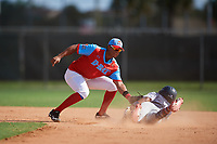 Jaider Morelos during the WWBA World Championship at the Roger Dean Complex on October 18, 2018 in Jupiter, Florida.  Nasim Nunez (7) slides in.  Jaider Morelos is a shortstop from St. Petersburg, Florida who attends Northside Christian High School and is committed to Florida International.  (Mike Janes/Four Seam Images)