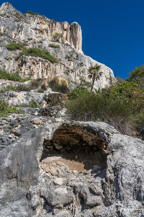 A small arch in the limestone below the Cascada Grande or the Big Waterfall mineral formation at Hierve el Agua, near Mitla, Mexico.