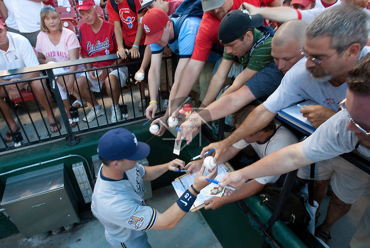 July 1, 2010       Milwaukee Brewers center fielder Jim Edmonds (15) signs autographs for fans before the game.  Edmonds is a former Cardinals player and is still very popular with the St. Louis hometown crowd.  The Milwaukee Brewers defeated the St. Louis Cardinals 4-1 in the first game of a four-game homestand at Busch Stadium in downtown St. Louis, MO on Thursday July 1, 2010.