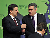 Washington, D.C. - November 15, 2008 -- Jose Manuel Barroso, President, European Commission left, and Gordon Brown, Prime Minister of the United Kingdom , right, share some thoughts as they posed for a class photo with other world leaders at the Summit on Financial Markets and the World Economy at the National Building Museum in Washington, D.C. on Saturday, November 15, 2008. .Credit: Ron Sachs / Pool via CNP
