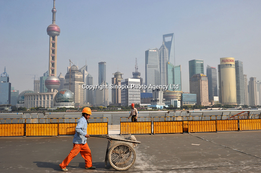 "The Shanghai Bund is under going a face-lift for the 2010 Shanghai Expo. The theme of Expo 2010 is ""Better City, Better Life,"" representing the common wish of the whole humankind for a better living in future urban environments.."