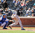 MICHAEL BOURN, of the Atlanta Braves, in action during the Braves game against the New York Mets on April 7, 2012 at Citi Field in Corona, NY. The Mets beat the Braves 4-2.