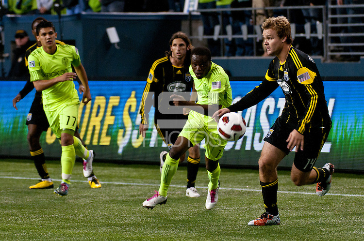 Chad Marshall(r) of the Columbus Crew  looks to pass as Seattle Sounder Steve Zakuani(c) defends as the Sounders defeated the Crew 2-1 to win the 2010 US Open Cup Championship  at the XBox 360 Pitch at Quest Field in Seattle, WA on October 5, 2010.