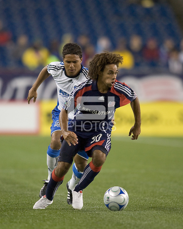 New England Revolution defender Kevin Alston (30) brings the ball out. The New England Revolution defeated San Jose Earthquakes, 2-1, at Gillette Stadium on August 29, 2009.