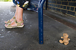 """Folkstone Triennial public art exhibition. Kent UK 2008. Tracey Emin """"Baby Things"""". Teddy Bear at the central station under bench."""