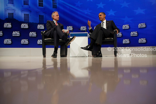 United States President Barack Obama and W. James McNerney, Jr. CEO of Boeing at the Asia-Pacific Economic Cooperation (APEC) CEO Summit at the Sheraton Waikiki Hotel  in Honolulu, Hawaii on Saturday, November 12, 2011..Credit: Kent Nishimura / Pool via CNP