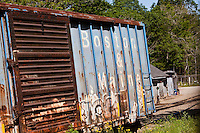 A railroad car of the Boston & Maine Corporation decays in Bucksport, Maine Wednesday June 19, 2013. Now part of the Pan Am Railways network, the Boston and Maine Corporation was the dominant railroad of the northern New England region of the United States for a century.
