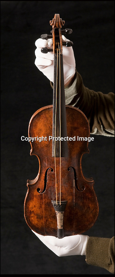 BNPS.co.uk (01202 558833)<br /> Pic: Phil Yeomans/BNPS<br /> <br /> And the band played on...<br /> <br /> The violin played by the bandmaster on the Titanic as the ship was sinking is finally being auctioned for an estimated £400,000.<br /> <br /> The wooden instrument has been proven to be the one used by Wallace Hartley as his band famously played on to help keep the passengers calm during the disaster.<br /> <br /> Its existence and survival only emerged in 2006 when the son of an amateur violinist who was gifted it by her music teacher in the early 1940s contacted an auctioneers.