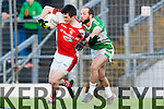 Paul Murphy Rathmore is pulled up by Legion Kieran Slattery during the O'Donoghue Cup final in Fitzgerald Stadium on Sunday