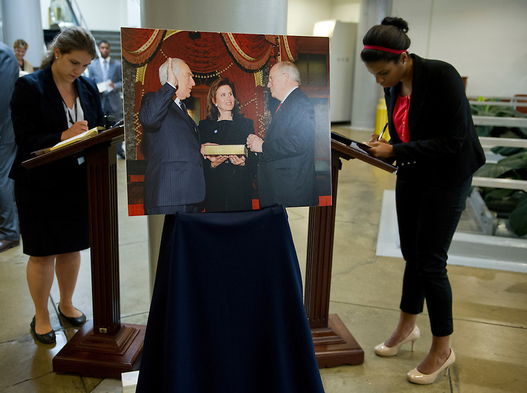 UNITED STATES - June 6: Staffers and visitors sign a guest book set up in the Senate subway for the late Senator Frank Lautenberg, D-NJ., who died at the age of 89 on June 6, 2013. Lautenberg, who was the last World War II veteran in the Senate, served in the Senate from 1982 to 2001 and then again from 2003 until his death.  (Pool Photo By Douglas Graham/CQ Roll Call)