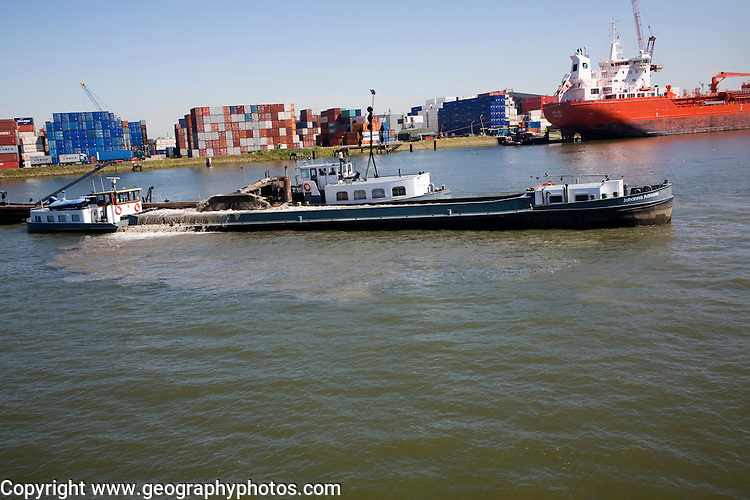 Dredger working to deepen the channel of the River Maas, Port of Rotterdam, Netherlands