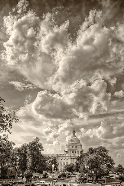 United States Capitol Building Washington DC.Washington DC Photography <br /> The United States Capitol building is located on Capitol Hill at the East end of the National Mall in Washington D.C.. The US Capitol building is among the most symbolically important and architecturally impressive buildings in the United States. It has housed the meeting chambers of the House of Representatives and the Senate for two centuries. An example of 19th-century neoclassical architecture. Architectural details include, columns, porticos, arches, steps, the capitol dome, rotunda. A Washington DC landmark and national icon it is a popular tourist attraction and travel destination in Washington DC.