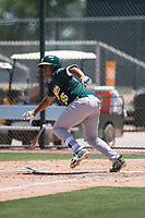Oakland Athletics catcher Santis Sanchez (55) starts down the first base line during an Extended Spring Training game against the San Francisco Giants Orange at the Lew Wolff Training Complex on May 29, 2018 in Mesa, Arizona. (Zachary Lucy/Four Seam Images)